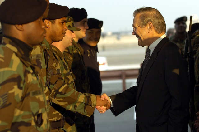 031115-F-2828D-046 Secretary of Defense Donald H. Rumsfeld shakes hands with Air Force Security Forces airmen while visiting Yokota Air Base, Japan, on Nov. 15, 2003.  Rumsfeld is traveling to Guam, Japan and South Korea to meet with U.S. military forces and the local military and civilian leadership.  DoD photo by Tech. Sgt. Andy Dunaway, U.S. Air Force. (Released)
